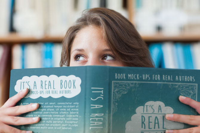 free book mock-up -woman peaking over top-of book